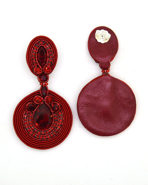 Massive earrings with Swarovski stones in red color