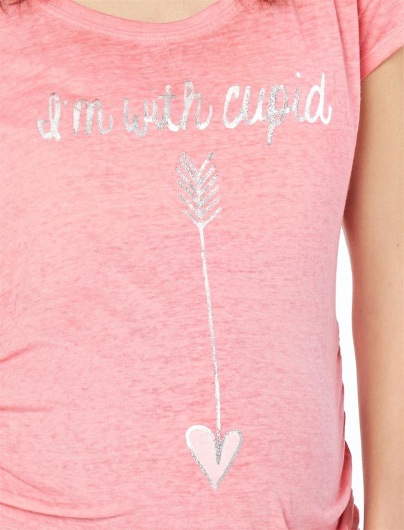 """Light pink maternity tee with silver graphic saying """"I'm with cupid"""". Stretch fabric. 58% polyester 42% cotton. Machine washable."""