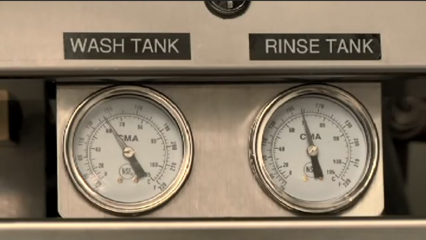 Check temperature gauges for the wash and rinse tanks.