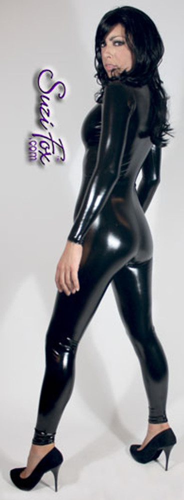 """Custom Catsuit by Suzi Fox shown in Black Gloss Black Vinyl/PVC coated Nylon Spandex.  You can order this Catsuit in almost any fabric on this site.  • Available in black, red, white, light pink, neon pink, fuchsia, purple, royal blue, navy blue, turquoise, black matte (no shine), white matte (no shine) stretch vinyl coated spandex. • Your choice of front or back zipper (front zipper shown). • Optional 1 or 2-slider crotch zipper, and """"Selene"""" from Underworld TS Brass zipper, or aluminum circular slider zipper like Catwoman comic characters. • Optional wrist zippers • Optional ankle zippers • Optional finger loops • Made in the U.S.A."""