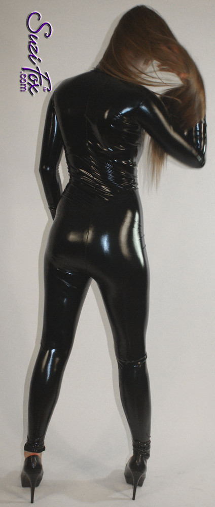 "Custom Catsuit by Suzi Fox shown in Black Gloss Black Vinyl/PVC coated Nylon Spandex.  You can order this Catsuit in almost any fabric on this site.  • Available in black, red, white, light pink, neon pink, fuchsia, purple, royal blue, navy blue, turquoise, black matte (no shine), white matte (no shine) stretch vinyl coated spandex. • Your choice of front or back zipper (front zipper shown). • Optional 2-slider crotch zipper, and ""Selene"" from Underworld TS Brass zipper, or aluminum circular slider zipper like Catwoman comic characters. • Made in the U.S.A."