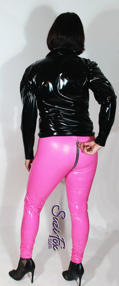 Womens Leggings shown in Neon Pink Gloss vinyl/PVC, with 2-slider crotch zipper, custom made by Suzi Fox.  Hiphugger rise shown. You can order this in almost any fabric on this site.  • Custom made to your measurements! • Available in black, red, white, light pink, neon pink, fuchsia, purple, royal blue, navy blue, turquoise, black matte (no shine), white matte (no shine) stretch vinyl coated spandex. • 1 inch elastic at the waist. • Optional 1 or 2-slider crotch zipper. • Optional ankle zippers • Optional rear patch pockets • Optional belt loops • Made in the U.S.A. We custom make every garment when you order it (including standard sizes).