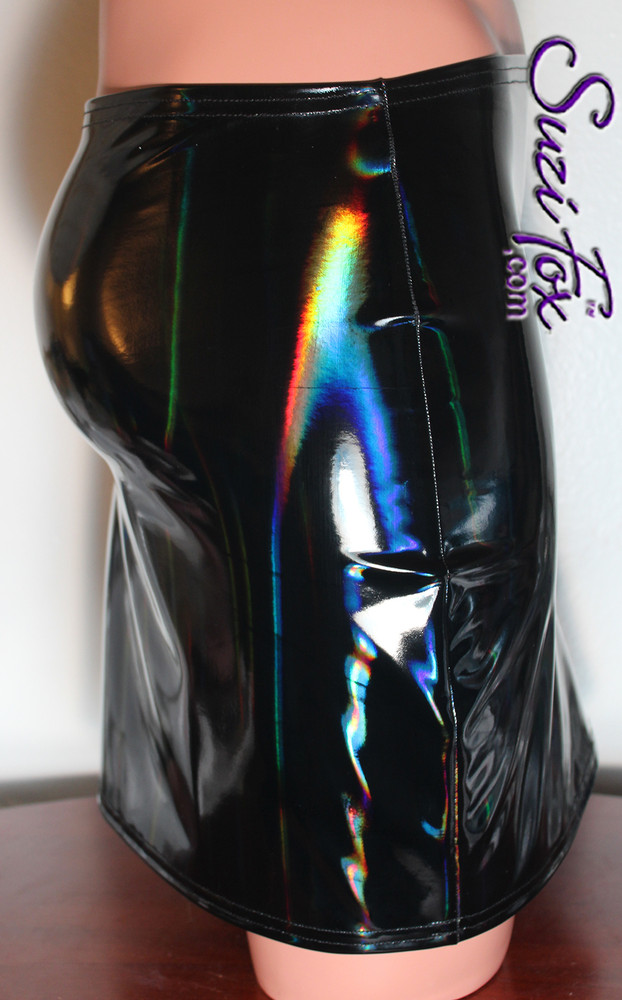Hiphugger Mini Skirt shown in Holographic Gloss Black Vinyl/PVC Spandex, custom made by Suzi Fox. This skirt is worn on the hip, not the waist. Brilliant colors on gloss black that change in the light!  • Choose any fabric on this site, including vinyl/PVC, metallic foil, metallic mystique, wetlook lycra Spandex, Milliskin Tricot Spandex. The vinyl/PVC is a latex alternative, great for people allergic to latex! • Custom sizing available • Plus size available • Worldwide shipping. • Made in the U.S.A.