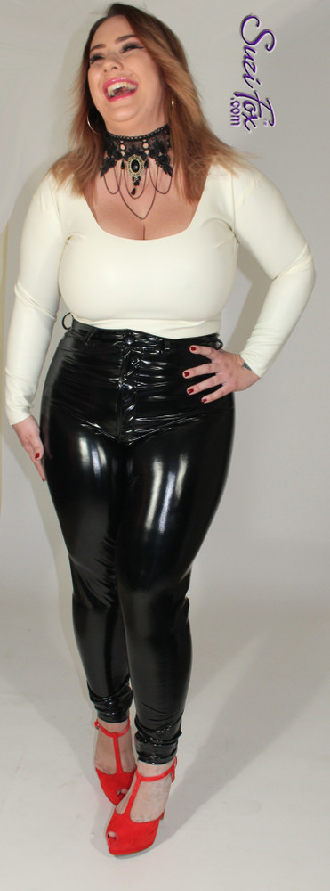 Custom Jean style Leggings shown in Black Gloss Vinyl/PVC coated Nylon Spandex, by Suzi Fox. • Waistband with button. • Fly front with zipper. • Choose any fabric on this site, including vinyl/PVC, metallic foil, metallic mystique, wetlook lycra Spandex, Milliskin Tricot Spandex. The vinyl/PVC is a latex alternative, great for people allergic to latex! • Optional custom sizing. • Plus size available. • Optional rear patch pockets. • Optional belt loops. • Optional ankle zippers. • Worldwide shipping. • Made in the U.S.A.