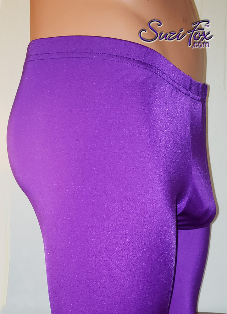 Pouch Front pants shown in Purple Milliskin Tricot Spandex, custom made by Suzi Fox. • 1 inch elastic at the waist. • Choose any fabric on this site, including vinyl/PVC, metallic foil, metallic mystique, wetlook lycra Spandex, Milliskin Tricot Spandex. • Custom sizing available. • Plus size available. • Optional rear patch pockets. • Optional belt loops. • Optional ankle zippers. • Worldwide shipping. • Made in the U.S.A.