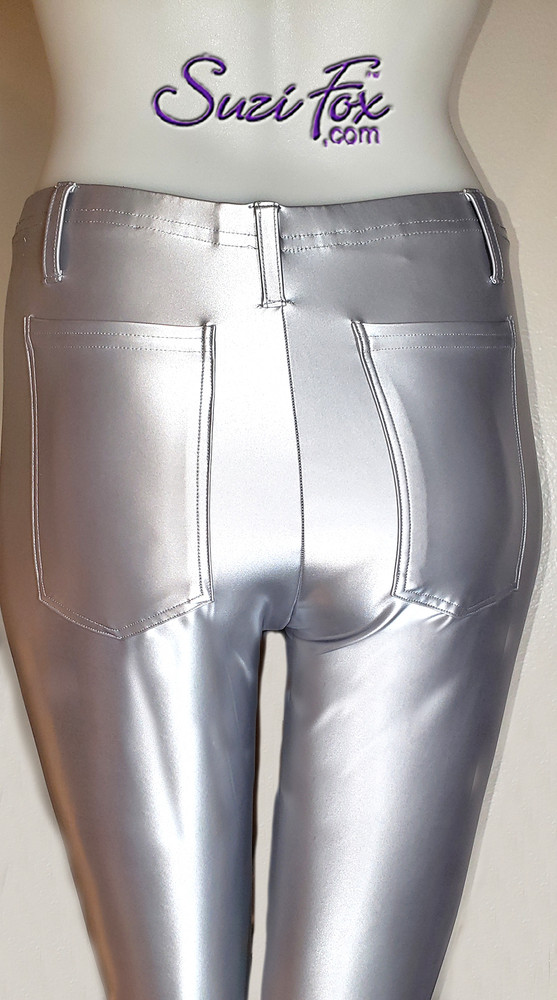 Womens Leggings shown in Silver Vinyl Polyester, custom made by Suzi Fox. • Choose any fabric on this site, including vinyl/PVC, metallic foil, metallic mystique, wetlook lycra Spandex, Milliskin Tricot Spandex. The vinyl/PVC is a latex alternative, great for people allergic to latex! • Optional custom sizing. • Plus size available. • 1 inch elastic at the waist. • Optional rear patch pockets. • Optional belt loops. • Optional ankle zippers. • Optional 1 or 2-slider crotch zipper. • Worldwide shipping. • Made in the U.S.A.