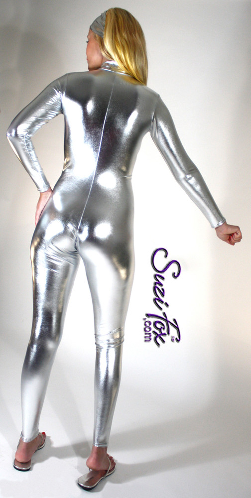 """Custom Catsuit by Suzi Fox shown in Silver metallic foil coated Nylon Spandex.  You can order this Catsuit in almost any fabric on this site.  • Available in gold, silver, copper, royal blue, purple, turquoise, red, green, fuchsia, gun metal, black faux leather/rubber Metallic foil coated spandex. • Your choice of front or back zipper (front zipper shown). • Optional 1 or 2-slider crotch zipper, and """"Selene"""" from Underworld TS Brass zipper, or aluminum circular slider zipper like Catwoman comic characters. • Optional wrist zippers • Optional ankle zippers • Optional finger loops • Optional rear patch pockets • Made in the U.S.A."""