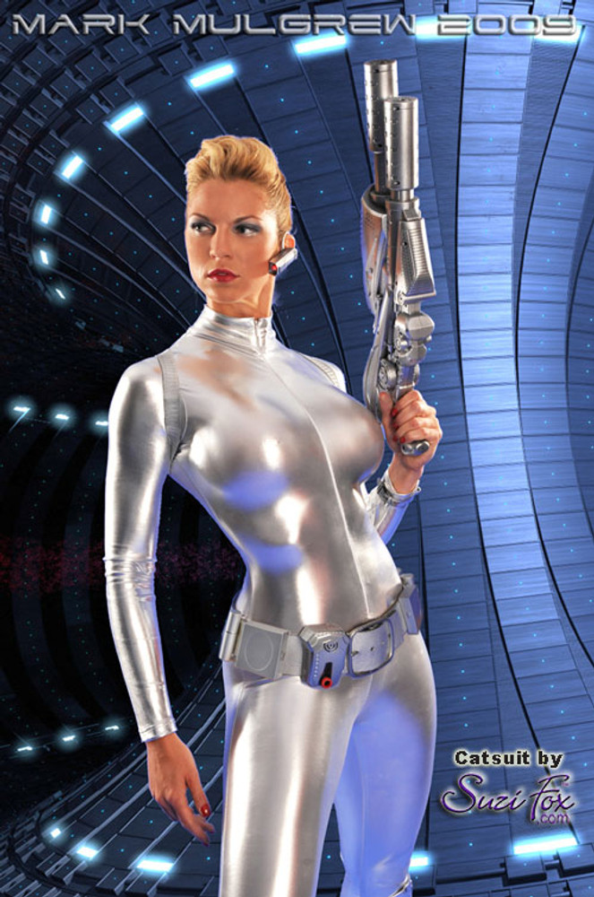 """Customer picture of Custom Catsuit by Suzi Fox shown in Silver metallic foil coated Nylon Spandex.  Art by Mark Mulgrew. You can order this Catsuit in almost any fabric on this site.  • Available in gold, silver, copper, royal blue, purple, turquoise, red, green, fuchsia, gun metal, black faux leather/rubber Metallic foil coated spandex. • Your choice of front or back zipper (front zipper shown). • Optional 1 or 2-slider crotch zipper, and """"Selene"""" from Underworld TS Brass zipper, or aluminum circular slider zipper like Catwoman comic characters. • Optional wrist zippers • Optional ankle zippers • Optional finger loops • Optional rear patch pockets • Made in the U.S.A."""