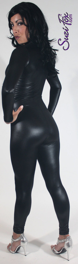 """Custom Catsuit by Suzi Fox shown in Black Wet Look Lycra Spandex.  You can order this Catsuit in almost any fabric on this site.  • Available in black, red, white, turquoise, navy blue, hot pink, lime green, green, yellow, royal blue, steel gray, neon orange. This is a 4-way stretch fabric with a medium shine. • Your choice of front or back zipper (front zipper shown). • Optional 1 or 2-slider crotch zipper, and """"Selene"""" from Underworld TS Brass zipper, or aluminum circular slider zipper like Catwoman comic characters. • Optional wrist zippers • Optional ankle zippers • Optional finger loops • Optional rear patch pockets • Made in the U.S.A."""