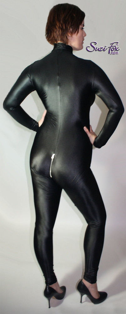 "Custom Catsuit by Suzi Fox shown in Black Wet Look Lycra Spandex. Shown with 2-slider crotch zipper. You can order this Catsuit in almost any fabric on this site.  • Available in black, red, white, turquoise, navy blue, hot pink, lime green, green, yellow, royal blue, steel gray, neon orange. This is a 4-way stretch fabric with a medium shine. • Your choice of front or back zipper (front zipper shown). • Optional 1 or 2-slider crotch zipper, and ""Selene"" from Underworld TS Brass zipper, or aluminum circular slider zipper like Catwoman comic characters. • Optional wrist zippers • Optional ankle zippers • Optional finger loops • Optional rear patch pockets • Made in the U.S.A."