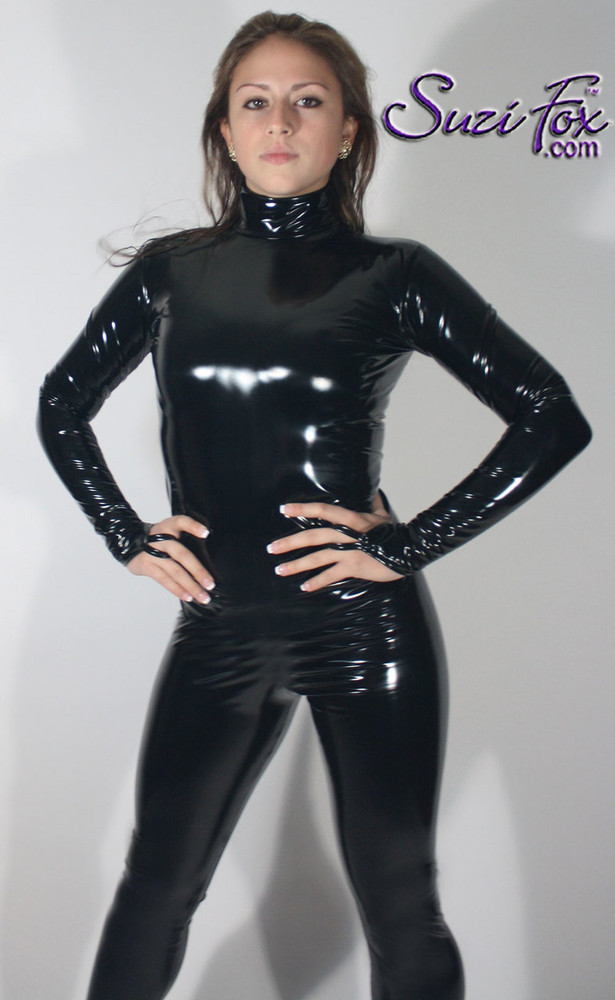 "Womens Custom Smooth Front (Back Zipper) Catsuit by Suzi Fox shown in Gloss Black Vinyl/PVC coated Nylon Spandex. • Choose any fabric on this site, including vinyl/PVC, metallic foil, metallic mystique, wetlook lycra Spandex, Milliskin Tricot Spandex. • Optional Custom Sizing. • Plus sizes available. • Optional ""Selene"" from Underworld TS zipper.  • Optional wrist zippers. • Optional ankle zippers. • Worldwide shipping. • Made in the U.S.A. Model - Crystal Silva, Musician"