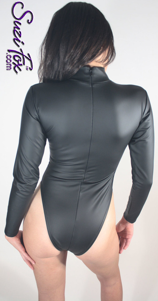 Custom Leotard  shown in Matte Black (no shine) Vinyl/PVC, custom made by Suzi Fox.  You can order this Leotard in almost any fabric on this site.  • Available in matte (no shine) black, matte (no shine) white; gloss black, white, red, neon pink, light pink, fuchsia, purple, royal blue, navy blue, turquoise gloss. This fabric is a 4-way stretch, vinyl/PVC coated spandex. • Your choice of rears - French legs (Rio), Cheeky, Full, or Thong. • Made in the U.S.A.
