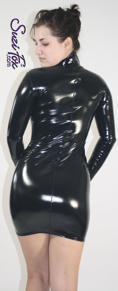 Turtleneck, Long Sleeved Mini Dress in Gloss Black Vinyl coated Nylon Spandex, custom made by Suzi Fox. Zipper in the back. Choose any fabric on this site! Available in black, white, red, navy blue, royal blue, turquoise, purple, fuchsia, neon pink, light pink, matte black (no shine), matte white (no shine) stretch vinyl/PVC coated nylon spandex. • Optional 2-slider zipper going the length of the dress, front or back, unzip from the top of the bottom! • Optional wrist zippers. Made in the U.S.A.