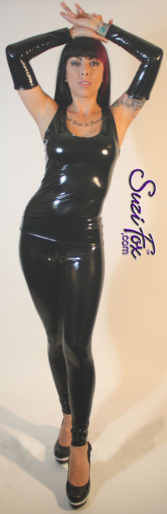 Custom Leggings shown in Black Gloss Vinyl/PVC coated Nylon Spandex, by Suzi Fox. • Choose any fabric on this site, including vinyl/PVC, metallic foil, metallic mystique, wetlook lycra Spandex, Milliskin Tricot Spandex. The vinyl/PVC is a latex alternative, great for people allergic to latex! • Optional custom sizing. • Plus sizes available. • 1 inch elastic at the waist. • Optional rear patch pockets. • Optional belt loops. • Optional ankle zippers. • Optional 1 or 2-slider crotch zipper. • Worldwide shipping. • Made in the U.S.A.