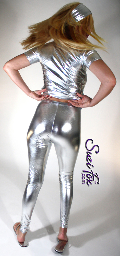 Womens Leggings shown in Silver Metallic Foil Spandex, custom made by Suzi Fox. Waist high rise shown. You can order this in almost any fabric on this site.  • Custom made to your measurements! • Available in gold, silver, copper, royal blue, purple, turquoise, red, green, fuchsia, gun metal, black faux leather/rubber coated spandex. This is a 4-way stretch fabric with a brilliant shine. • 1 inch elastic at the waist. • Optional 1 or 2-slider crotch zipper. • Optional ankle zippers • Optional rear patch pockets • Optional belt loops • Made in the U.S.A.