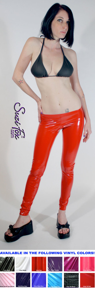 Womens Leggings shown in Red Gloss vinyl/PVC, custom made by Suzi Fox.  Super Low rise shown. You can order this in almost any fabric on this site.  • Custom made to your measurements! • Available in black, red, white, light pink, neon pink, fuchsia, purple, royal blue, navy blue, turquoise, black matte (no shine), white matte (no shine) stretch vinyl coated spandex. • 1 inch elastic at the waist. • Optional 1 or 2-slider crotch zipper. • Optional ankle zippers • Optional rear patch pockets • Optional belt loops • Made in the U.S.A.