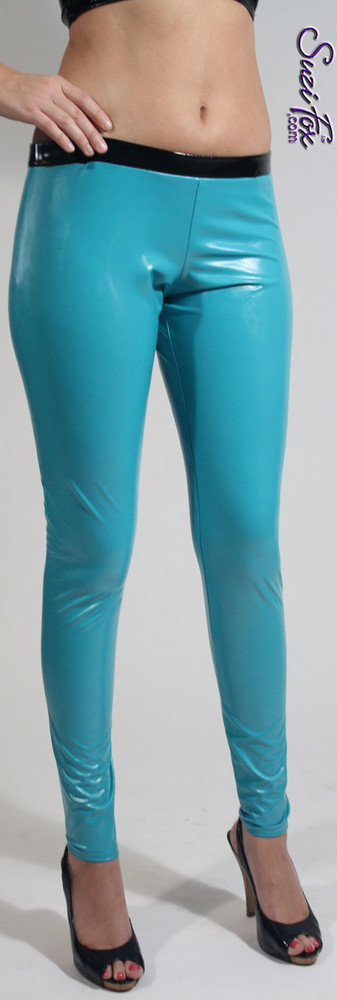 "Womens Leggings shown in Turquoise Vinyl/PVC, Featured in the play RENT, custom made by Suzi Fox.  Shown with black waistband as seen in the play ""RENT."" You can order this in almost any fabric on this site.  • Custom made to your measurements! • Available in gloss black, white, red, navy blue, royal blue, turquoise, purple, neon pink, fuchsia, light pink, matte (no shine) black, matte (no shine) white. 4 way stretch, great alternative to latex! • 1 inch elastic at the waist. • Optional 1 or 2-slider crotch zipper. • Optional ankle zippers • Optional rear patch pockets • Optional belt loops • Made in the U.S.A."