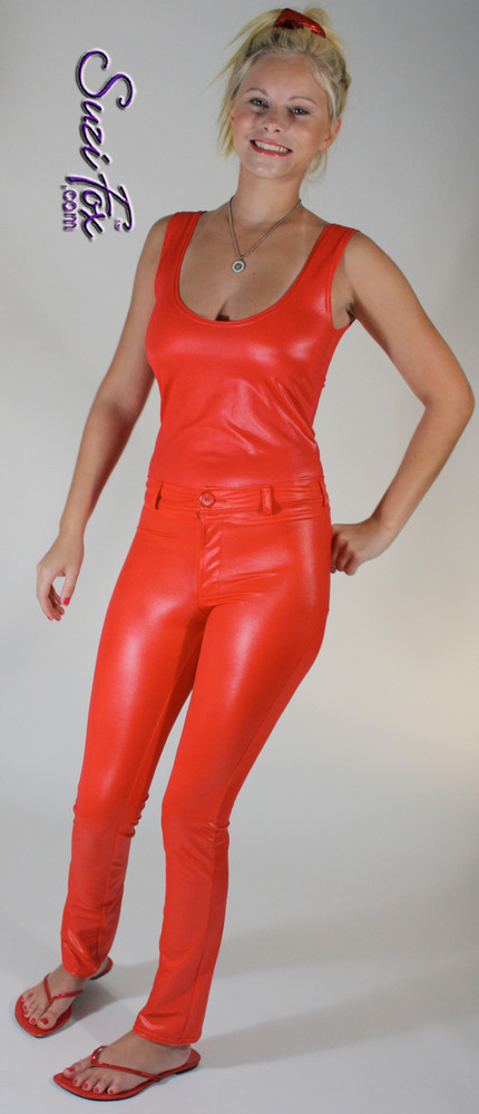 Womens Jean style pants shown in Red Wet Look Lycra Spandex, custom made by Suzi Fox. • Choose any fabric on this site, including vinyl/PVC, metallic foil, metallic mystique, wetlook lycra Spandex, Milliskin Tricot Spandex. • Waistband, Button and front fly zipper. • Standard rear patch pockets. • Standard belt loops. • Optional ankle zippers. • Made in the U.S.A., Worldwide shipping.