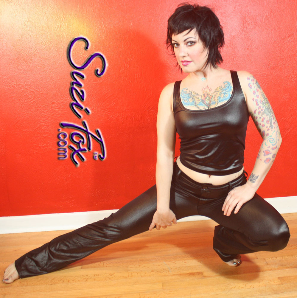 Womens Jean style pants shown in Black Wet Look Lycra Spandex, custom made by Suzi Fox. • Choose any fabric on this site, including vinyl/PVC, metallic foil, metallic mystique, wetlook lycra Spandex, Milliskin Tricot Spandex. • Waistband, Button and front fly zipper. • Standard rear patch pockets. • Standard belt loops. • Optional ankle zippers. • Made in the U.S.A., Worldwide shipping.