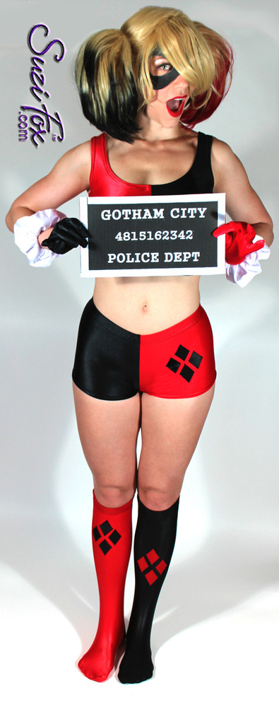 Harley Quinn Stockings shown in Black & Red Wetlook Lycra/Spandex custom made by Suzi Fox. Diamonds on each stocking. 1 inch elastic at the top. Popular fabrics are: red & black vinyl/PVC, red & black metallic foil, red & black wet look lycra Spandex. Made in the U.S.A.