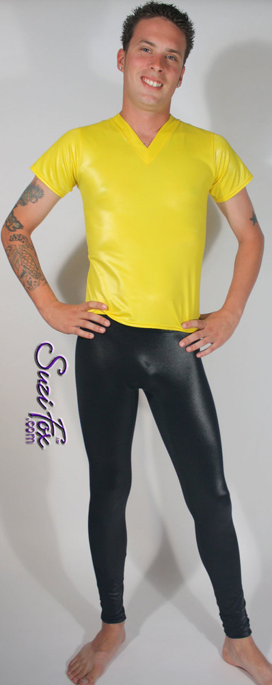 Mens Smooth Front, Hiphugger Leggings shown in Black Wetlook Lycra Spandex, custom made by Suzi Fox. Custom made to your measurements! • 1 inch no-roll elastic at the waist. • Choose your ankle size - tight ankles, jean cut, boot cut, or bellbottom. • Optional ankle zippers. • Optional belt loops. • Optional rear patch pockets. Made in the U.S.A.