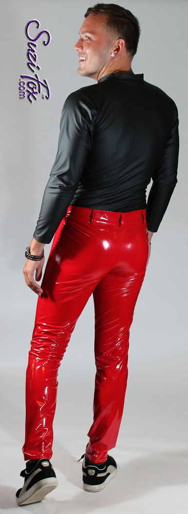 Mens Jean style Pants shown in Gloss Red Vinyl/PVC Spandex, custom made by Suzi Fox. Custom made to your measurements! • Front fly zipper, and waistband. • Available in gloss black, white, red, navy blue, royal blue, turquoise, purple, Neon Pink, fuchsia, light pink, matte black (no shine), matte white (no shine), black 3D Prism, red 3D Prism, Turquoise 3D Prism, Baby Blue 3D Prism, Hot Pink 3D Prism Vinyl and any fabric on this site. • Choose your ankle size - tight ankles, jean cut, boot cut, or bellbottom. • Optional ankle zippers. • Optional belt loops. • Optional rear patch pockets. Made in the U.S.A.