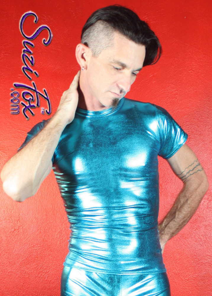 Mens Tee Shirt shown in Turquoise Metallic Foil Spandex, custom made by Suzi Fox. • Available in gold, silver, copper, gunmetal, turquoise, Royal blue, red, green, purple, fuchsia, black faux leather/rubber Metallic Foil, and any fabric on this site. • Choose your sleeve length. • Give us your measurements for a custom fit! • Standard length is 24 inches (61 cm) for sizes XXXS-Medium; 27 inches (68.6 cm) for sizes Large and up. • Optional add extra length to the shirt. • Made in the U.S.A.
