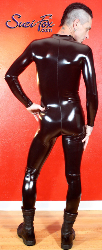 Mens Custom Catsuit shown in Gloss Black vinyl/PVC, custom made by Suzi Fox. • Available in black, white, red, navy blue, royal blue, turquoise, purple, Neon Pink, fuchsia, light pink, matte black (no shine), matte white (no shine), black 3D Prism, red 3D Prism, Turquoise 3D Prism, Baby Blue 3D Prism, and any fabric on this site. • Optional 1 or 2-slider crotch zipper. • Optional wrist zippers • Optional ankle zippers • Optional finger loops • Made in the U.S.A.