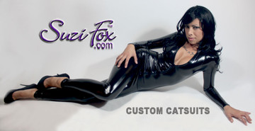 """Custom Catsuit by Suzi Fox shown in Black Gloss Black Vinyl/PVC coated Nylon Spandex.  You can order this Catsuit in almost any fabric on this site.  • Available in black, red, white, light pink, neon pink, fuchsia, purple, royal blue, navy blue, turquoise, black matte (no shine), white matte (no shine), 3D black, 3D red stretch vinyl coated spandex. • Optional 1 or 2-slider crotch zipper, and """"Selene"""" from Underworld TS Brass zipper. • Optional wrist zippers • Optional ankle zippers • Optional finger loops • Made in the U.S.A."""