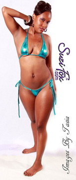 Teardrop String Bikini Top shown in Turquoise Metallic Foil Spandex, custom made by Suzi Fox. • One Size. 3 inches (7.6 cm) wide at widest point, 7 inches (17.8 cm) tall. • Available in gold, silver, copper, gunmetal, turquoise, Royal blue, red, green, purple, fuchsia, black faux leather/rubber Metallic Foil, and any fabric on this site. • Bottom sold separately. (Micro String Thong Item#: B34 shown) • Crafted in the U.S.A. Photo by Images by Tasia