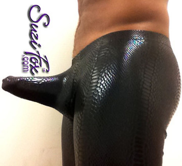 Thruster Pouch Front pants, custom made by Suzi Fox.  Pouch holds the penis straight out the front. • 1 inch elastic at the waist. • Choose any fabric on this site, including vinyl/PVC, metallic foil, metallic mystique, wetlook lycra Spandex, Milliskin Tricot Spandex. • Optional rear patch pockets. • Optional belt loops. • Optional ankle zippers. • Worldwide shipping. • Crafted in the U.S.A.