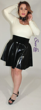 Circle Skirt/Skater Skirt shown in black shined Latex Rubber, custom made by Suzi Fox. Waistband is 6 inches tall, goes to the underbust. • Zipper in the back with zipper choices. • Custom sizing • Plus size available   Sizing may vary slightly. • Worldwide shipping. • Made in the U.S.A.