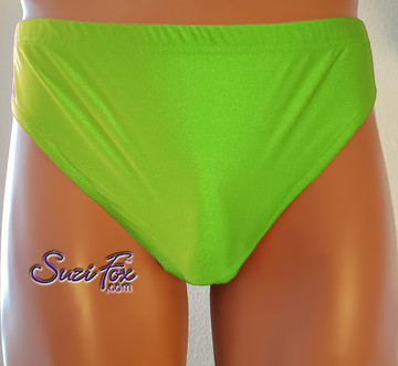 T-Back brief by Suzi Fox.  shown in Neon Green Milliskin Tricot Spandex. 1 inch elastic at the waist, elastic in the legs. • Wear it as swimwear, or underwear! • Plus size available. • You can choose any fabric on this site, including vinyl/PVC, Metallic Foil, Metallic Mystique, Wetlook Lycra Spandex, Milliskin Tricot Spandex. The vinyl/PVC is a latex alternative, great for people allergic to latex! • Worldwide shipping. • Made in the U.S.A. We custom make every garment when you order it (including standard sizes).
