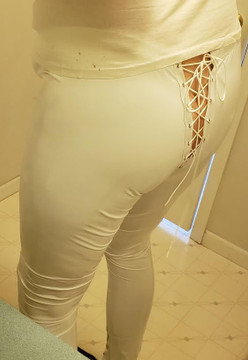 Mens Hiphugger Leggings with OPTIONAL Grommet Lacing, shown in Gloss White Vinyl/PVC Spandex, custom made by Suzi Fox. • Choose any fabric on this site, including vinyl/PVC, metallic foil, metallic mystique, wetlook lycra Spandex, Milliskin Tricot Spandex. The vinyl/PVC is a latex alternative, great for people allergic to latex! • Custom sizing available. • Plus size available. • 1 inch elastic at the waist. • Optional rear patch pockets. • Optional belt loops. • Optional ankle zippers. • Optional Faux zipper pockets. • Worldwide shipping. • Made in the U.S.A.