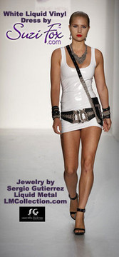 Sunday, September 12, 2009, in New York City the show featured Liquid Metal Jewelry by Sergio Gutierrez in his Spring 2010 fashion show. For the most part, Gutierrez designs accessories. How does an accessory walk down a runway?                          On a Suzi Fox Skin Tight White Liquid Vinyl Mini Dress!