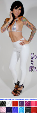 Custom Leggings shown in White Gloss Vinyl/PVC coated Nylon Spandex, by Suzi Fox. • Choose any fabric on this site, including vinyl/PVC, metallic foil, metallic mystique, wetlook lycra Spandex, Milliskin Tricot Spandex. The vinyl/PVC is a latex alternative, great for people allergic to latex! • Optional custom sizing. • Plus sizes available. • 1 inch elastic at the waist. • Optional rear patch pockets. • Optional belt loops. • Optional ankle zippers. • Optional 1 or 2-slider crotch zipper. • Worldwide shipping. • Made in the U.S.A.