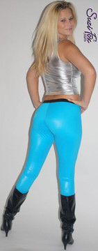 "Womens Mimi Marquez Leggings shown in Turquoise Wet Look Lycra Spandex, custom made by Suzi Fox.  Shown with optional black waistband as seen in the play ""RENT."" You can order this in almost any fabric on this site.  • Custom made to your measurements! • Available in black white, red, navy blue, royal blue, turquoise, hot pink, lime green, green, yellow, neon orange, steel gray. lycra spandex. This is a 4-way stretch fabric with a medium shine. Very comfortable! • 1 inch elastic at the waist. • Optional 1 or 2-slider crotch zipper. • Optional ankle zippers • Optional rear patch pockets • Optional belt loops • Made in the U.S.A."