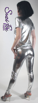 Womens Leggings shown in Silver Metallic Foil Spandex, custom made by Suzi Fox. Hip hugger rise shown. You can order this in almost any fabric on this site.  • Custom made to your measurements! • Available in gold, silver, copper, royal blue, purple, turquoise, red, green, fuchsia, gun metal, black faux leather/rubber coated spandex. This is a 4-way stretch fabric with a brilliant shine. • 1 inch elastic at the waist. • Optional 1 or 2-slider crotch zipper. • Optional ankle zippers • Optional rear patch pockets • Optional belt loops • Made in the U.S.A.