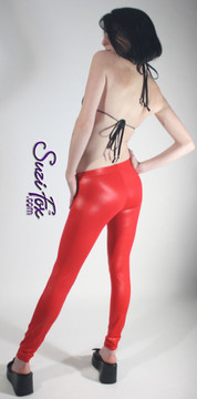 Womens Leggings shown in Red Wet Look Lycra Spandex, custom made by Suzi Fox. Shown in Super Low rise. You can order this in almost any fabric on this site.  • Custom made to your measurements! • Available in black white, red, navy blue, royal blue, turquoise, hot pink, lime green, green, yellow, neon orange, steel gray. lycra spandex. This is a 4-way stretch fabric with a medium shine. Very comfortable! • 1 inch elastic at the waist. • Optional 1 or 2-slider crotch zipper. • Optional ankle zippers • Optional rear patch pockets • Optional belt loops • Made in the U.S.A.