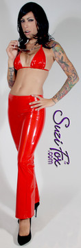 Womens Boot Cut Pants shown in Red Gloss vinyl/PVC, custom made by Suzi Fox.  Hiphugger rise shown. You can order this in almost any fabric on this site.  • Custom made to your measurements! • Available in black, red, white, light pink, neon pink, fuchsia, purple, royal blue, navy blue, turquoise, black matte (no shine), white matte (no shine) stretch vinyl coated spandex. • 1 inch elastic at the waist. • Optional 1 or 2-slider crotch zipper. • Optional ankle zippers • Optional rear patch pockets • Optional belt loops • Made in the U.S.A.