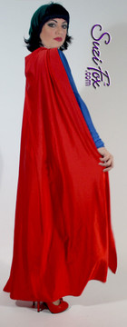 Superhero Cape shown in Red Shiny Milliskin Tricot Nylon Spandex, custom made by Suzi Fox. You can order this in almost any fabric on this site. • Available in black, white, red, royal blue, sky blue, turquoise, purple, green, neon green, hunter green, neon pink, neon orange, athletic gold, lemon yellow, steel gray Miilliskin Tricot spandex. This is a 4-way extreme stretch fabric with a slight shine. Light, airy, thin, and very comfortable! • String tie around the neck. • Made in the U.S.A.