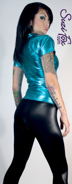 Womens T-Shirt in Turquoise Metallic Foil coated Spandex, custom made by Suzi Fox. Custom made to your measurements! Choose any fabric on this site! Available in gold, silver, copper, gunmetal, turquoise, Royal blue, red, green, purple, fuchsia, black faux leather/rubber. • Optional wrist zippers if you choose long sleeves. Made in the U.S.A.