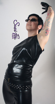 'Trinity' from the Matrix style muscle tee shown in Black Faux Leather/Rubber Metallic, custom made by Suzi Fox. Custom made to your measurements! Available in gold, silver, copper, gunmetal, turquoise, Royal blue, red, green, purple, fuchsia, black faux leather/rubber, and any other fabric on this site. Made in the U.S.A.