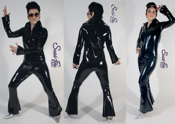 Custom Elvis Style Catsuit by Suzi Fox shown in Black Gloss Black Vinyl/PVC coated Nylon Spandex.  You can order this Catsuit in almost any fabric on this site.  • Available in black, red, white, light pink, neon pink, fuchsia, purple, royal blue, navy blue, turquoise, black matte (no shine), white matte (no shine) stretch vinyl coated spandex. • Optional 1 or 2-slider crotch zipper. • Optional wrist zippers • Optional ankle zippers • Optional finger loops • Made in the U.S.A.