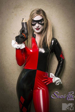 Customer Picture! She did Cosplay at Comic Con 2015 - photo by MTV! Custom Harley Quinn Catsuit by Suzi Fox in Stretch Gloss Red and Black Vinyl coated Nylon Spandex. Includes catsuit, gloves, wrist ruffles. Mask not included. Popular fabrics are: red & black vinyl/PVC, red & black metallic foil, red & black wet look lycra Spandex. • Optional 1 or 2-slider crotch zipper. • Optional wrist zippers • Optional ankle zippers • Made in the U.S.A.
