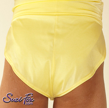 """Men's V front, Split Side Running/ Cover-Up Shorts shown in Yellow Milliskin Tricot Spandex, custom made by Suzi Fox. • Available in black, white, red, royal blue, sky blue, turquoise, purple, green, neon green, hunter green, neon pink, neon orange, athletic gold, lemon yellow, steel gray Miilliskin Tricot spandex, and any fabric on this site. • 1 inch no-roll elastic at the waist. • Front inside pouch. • The A15's are a """"V"""" shape in the front, with less fabric on the front of the leg, and a very thin crotch. Commonly worn by runners and marathon participants, the A15's offer less chafing between the legs and does not inhibit the legs. • Made in the U.S.A."""