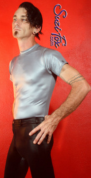 Mens Tee Shirt shown in Steel Gray Wetlook Lycra Spandex, custom made by Suzi Fox. • Available in black, white, red, turquoise, navy blue, royal blue, hot pink, lime green, green, yellow, steel gray, neon orange Wet Look, and any fabric on this site. • Choose your sleeve length. • Give us your measurements for a custom fit! • Standard length is 24 inches (61 cm) for sizes XXXS-Medium; 27 inches (68.6 cm) for sizes Large and up. • Optional add extra length to the shirt. • Made in the U.S.A.