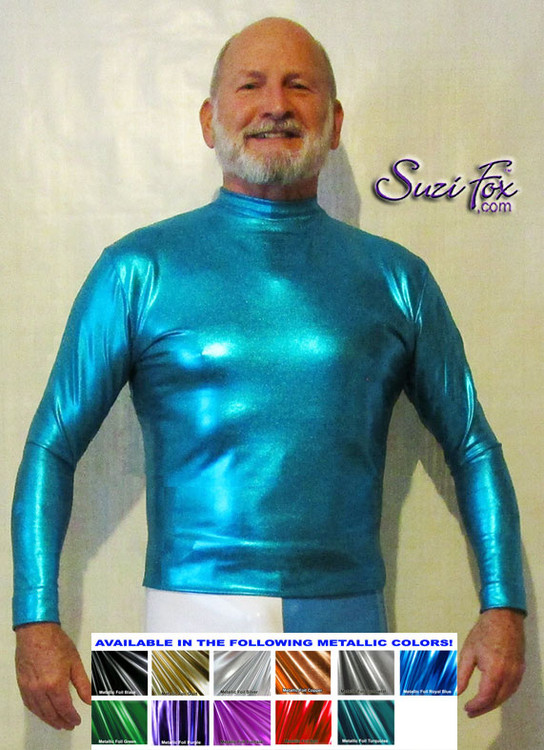 Mens long sleeve Tee Shirt shown in turquoise Metallic Foil Spandex, custom made by Suzi Fox. • Available in gold, silver, copper, gunmetal, turquoise, Royal blue, red, green, purple, fuchsia, black faux leather/rubber Metallic Foil, and any fabric on this site. • Choose your sleeve length. • Give us your measurements for a custom fit! • Standard length is 24 inches (61 cm) for sizes XXXS-Medium; 27 inches (68.6 cm) for sizes Large and up. • Optional add extra length to the shirt. • Made in the U.S.A. Many thanks to Robert Strong, professional piano player, for these awesome pictures!