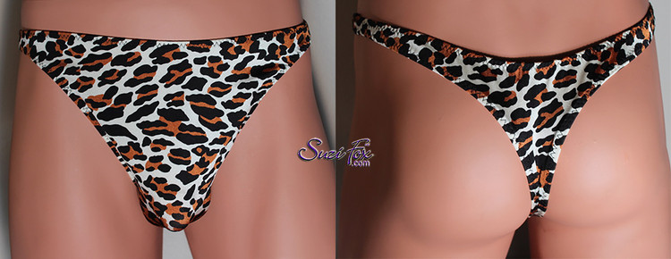 Mens Smooth Front, Wide Strap, T-Back thong for the well endowed man - shown in Leopard print Spandex, custom made by Suzi Fox. • Available in any fabric on this site. • Standard front height is 9 inches (22.9 cm). • Available in 3, 4, 5, 6, 7, 8, 9, and 10 inch front heights. • Wear it as swimwear OR underwear! • Made in the U.S.A.
