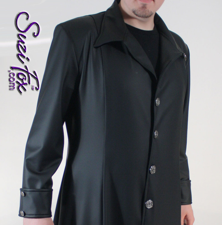 Men's Matrix Style Coat, shown in Black Matte Vinyl, custom made by Suzi Fox. • Elegant details, custom buttons, cuffs, back yoke, collar, chain detail in back. • Choose your length! • Choose any fabric on this site, including vinyl/PVC, metallic foil, metallic mystique, wetlook lycra Spandex, Milliskin Tricot Spandex. The vinyl/PVC is a latex alternative, great for people allergic to latex! • Worldwide shipping. • Made in the U.S.A.